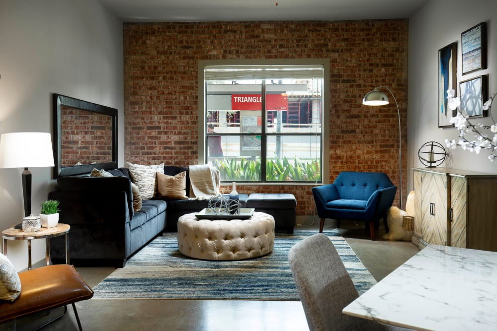 Beautiful living room brick wall at Residences at The Triangle in Austin, Texas