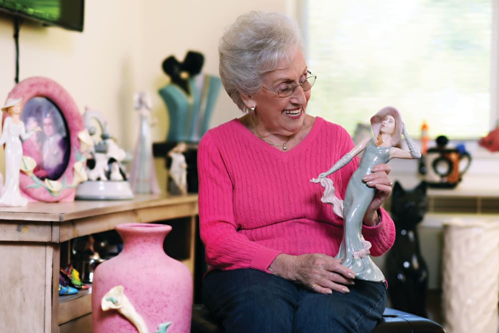 Senior woman holding ornament at Elegance at Novato in Novato, California