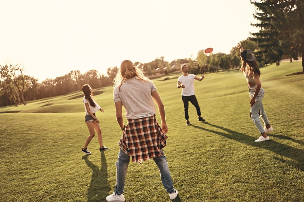 Residents playing soccer near UNCOMMON Raleigh in Raleigh, North Carolina