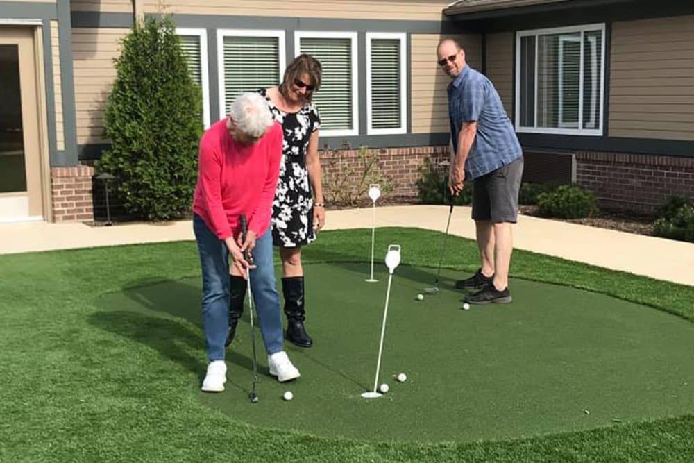 senior golfing on the putting green