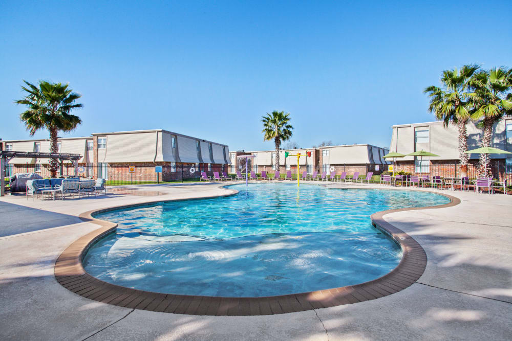 Sparkling pool at Emerald Pointe Apartment Homes In Harvey