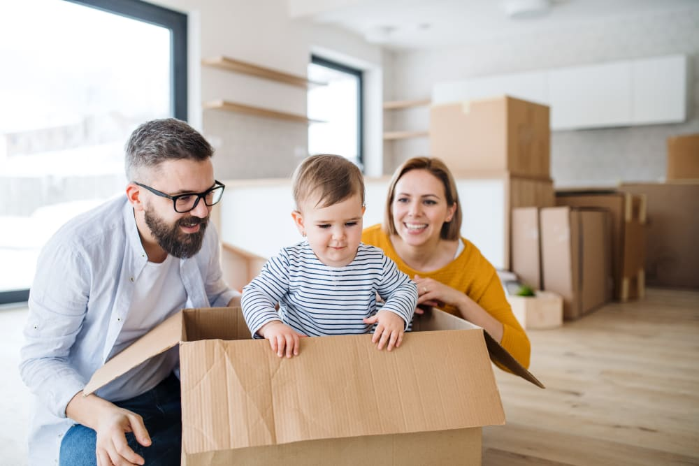 Family preparing items for storage in Jacksonville, Florida at Storage Units