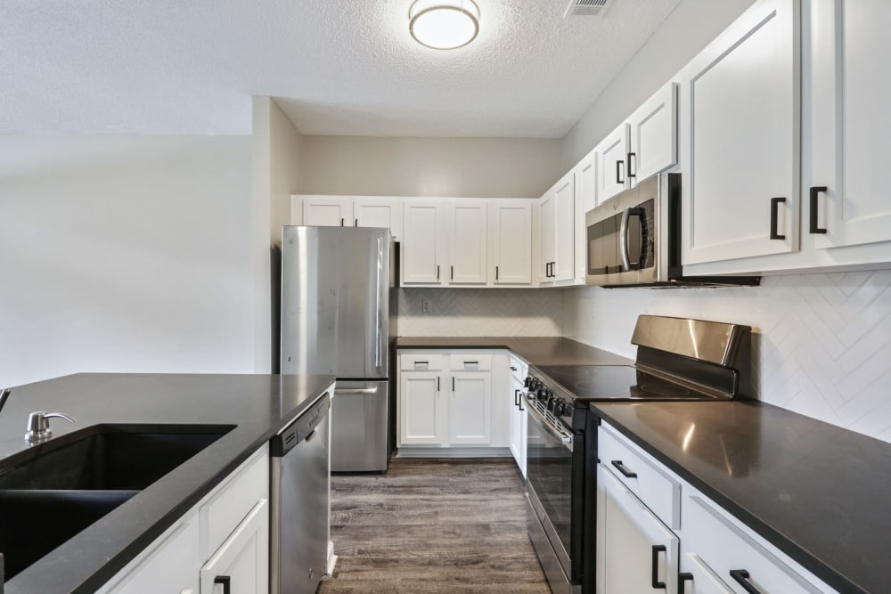 Kitchen with stainless appliances at Seventeen West in Atlanta