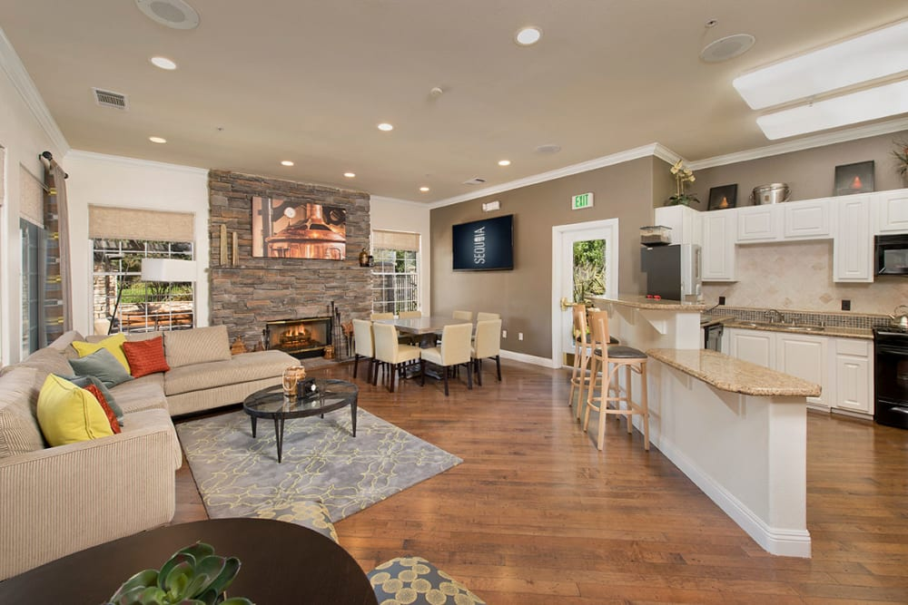 Clubhouse with plenty of seating for entertaining guests at River Oaks Apartment Homes in Vacaville, California