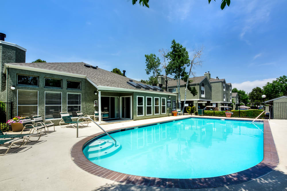 Resort-style swimming pool on a beautiful day at Waterfield Court Apartment Homes in Aurora, Colorado