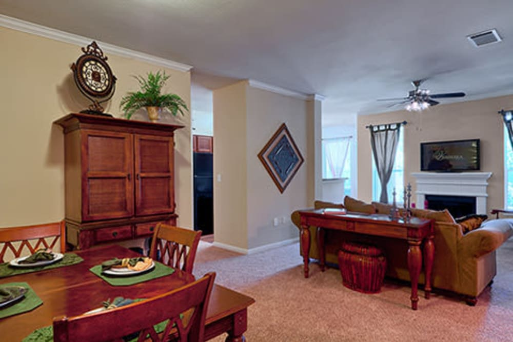 Spacious living room with plush carpeting at Somerset at Spring Creek in Plano, Texas