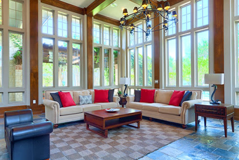 Resident lounge with large windows at Somerset at Spring Creek in Plano, Texas
