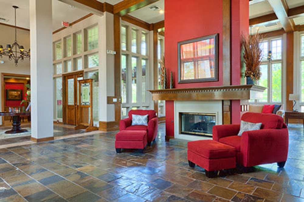 Large clubhouse with a fireplace at Somerset at Spring Creek in Plano, Texas