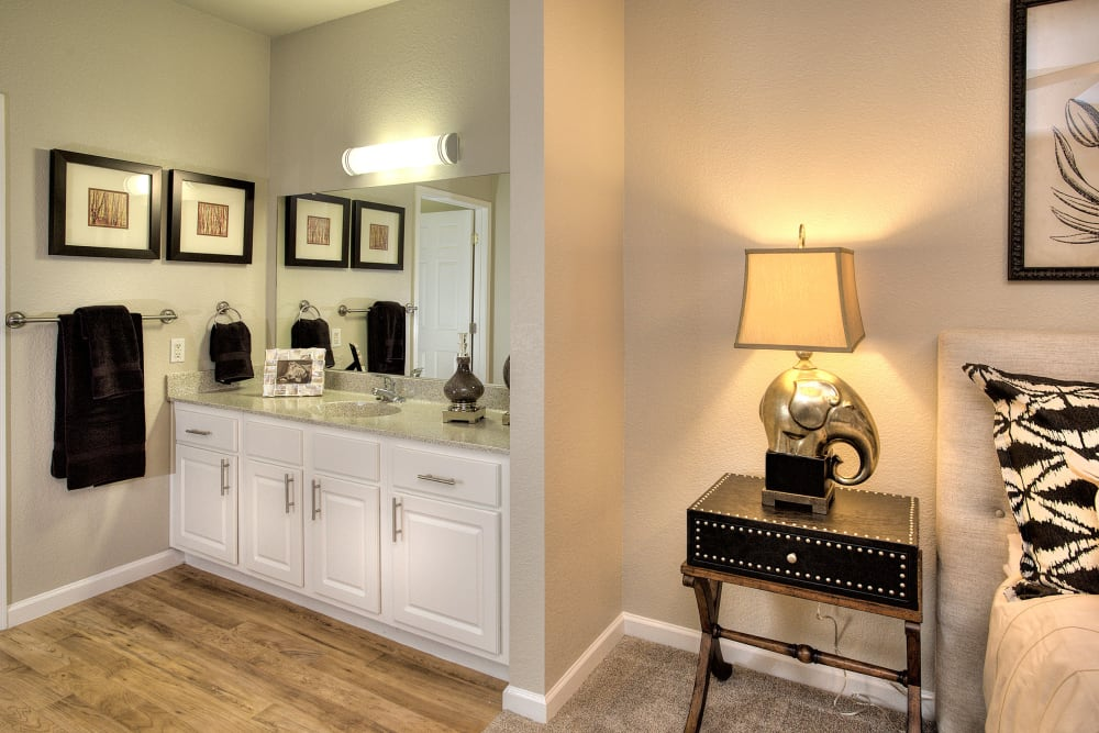 Spacious master bedroom with bathroom storage at River Oaks Apartment Homes in Vacaville, California