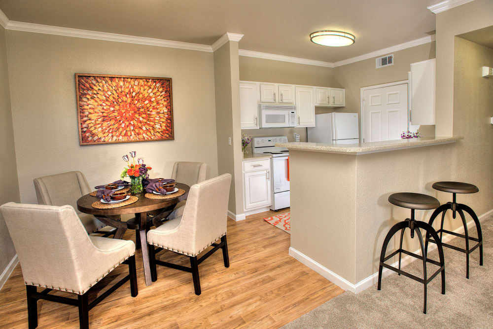 Kitchen with a breakfast bar at River Oaks Apartment Homes in Vacaville, California