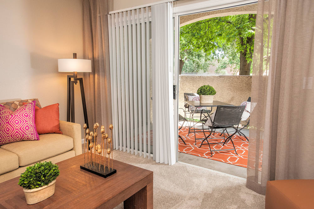 Living room with a private patio at River Oaks Apartment Homes in Vacaville, California