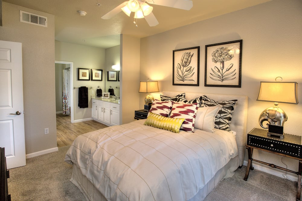 Spacious master bedroom with plush carpeting at River Oaks Apartment Homes in Vacaville, California