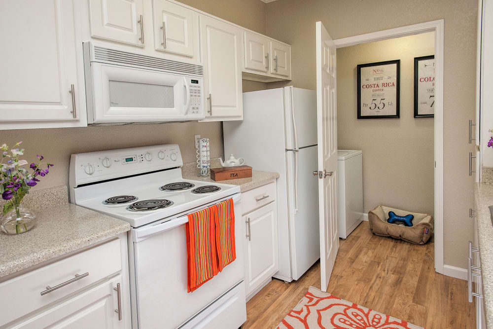 Spacious kitchen with modern amenities at River Oaks Apartment Homes in Vacaville, California