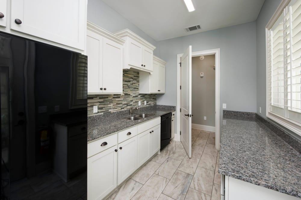 Subway tile backsplash in a model home's kitchen at The Enclave in Brunswick, Georgia