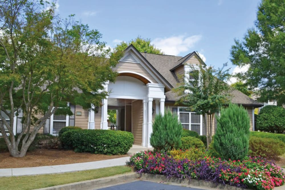 Exterior of the leasing office with professionally maintained landscaping at Azalea Springs in Marietta, Georgia