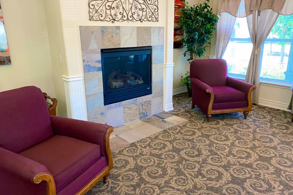 Lobby seating with fireplace at Evergreen Senior Living in Eugene, Oregon