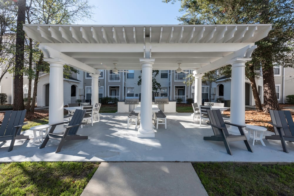 Outdoor community patio and grill area at Ingleside Apartments in North Charleston, South Carolina
