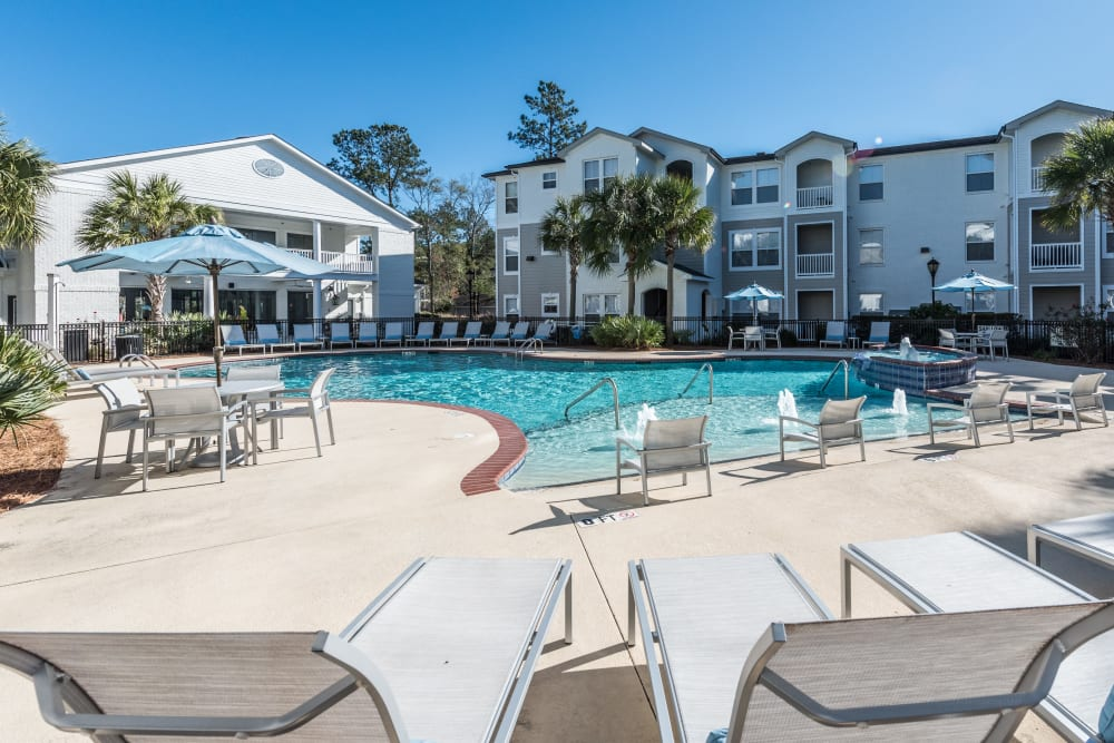 outdoor pool with lounge chairs at Ingleside Apartments in North Charleston, South Carolina