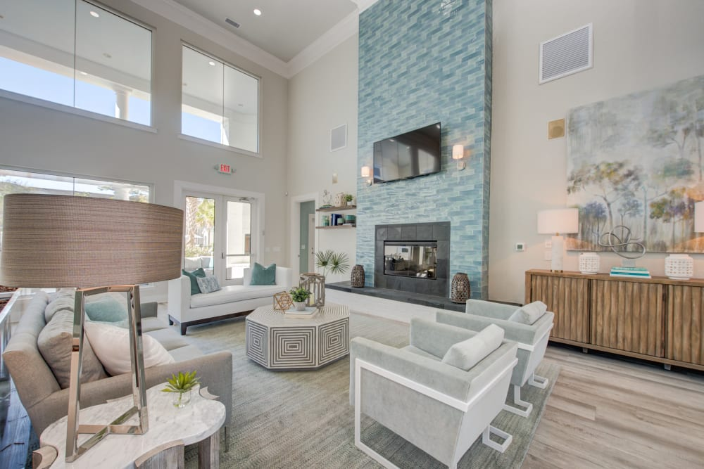 Interior lobby space with fireplace couches and chairs at Ingleside Apartments in North Charleston, South Carolina
