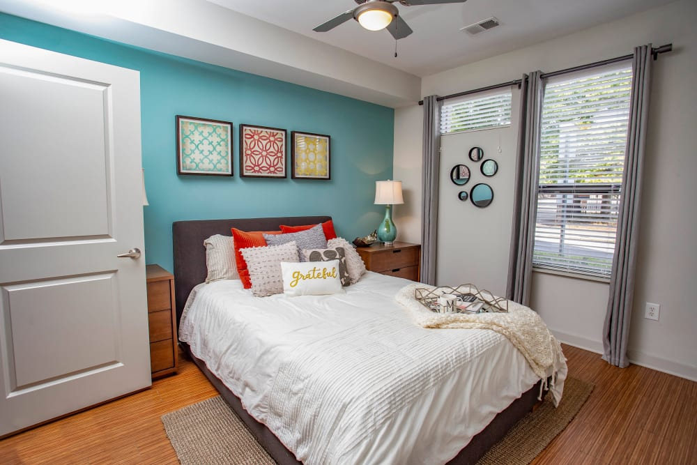 Accent wall and a ceiling fan in a model apartment's bedroom at Olympus Midtown in Nashville, Tennessee