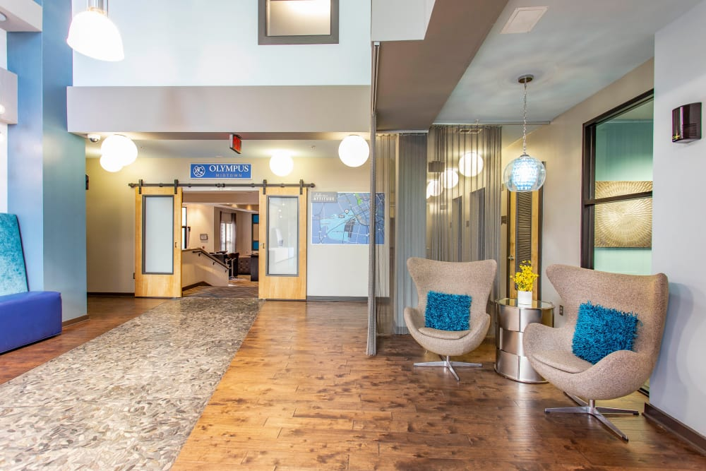 Welcoming lobby interior with comfortable places to relax at Olympus Midtown in Nashville, Tennessee