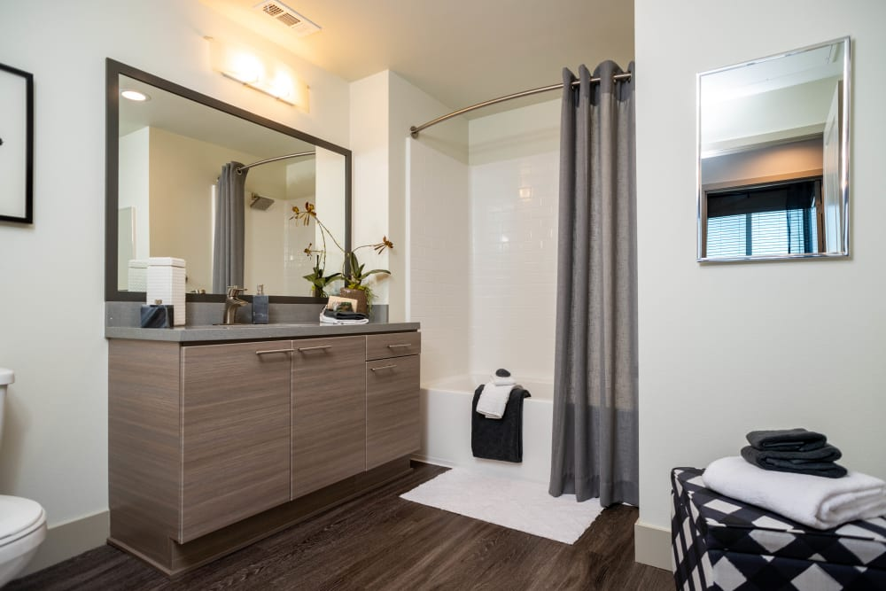 Large vanity mirror in a model home's bathroom at Fusion Apartments in Irvine, California
