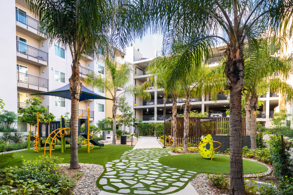 Beautifully manicured landscaping in an exterior courtyard at Fusion Apartments in Irvine, California