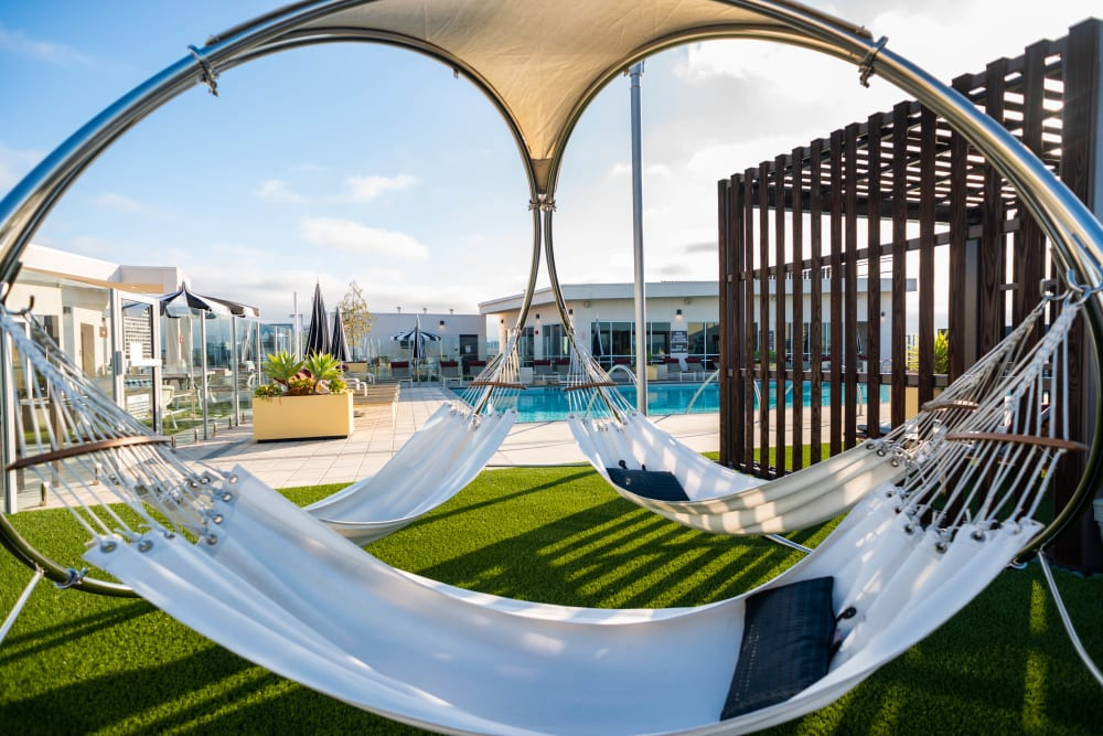 Shaded hammocks near the swimming pool at Fusion Apartments in Irvine, California