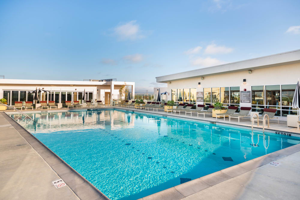 Resort-style swimming pool with underwater lap lane markers at Fusion Apartments in Irvine, California