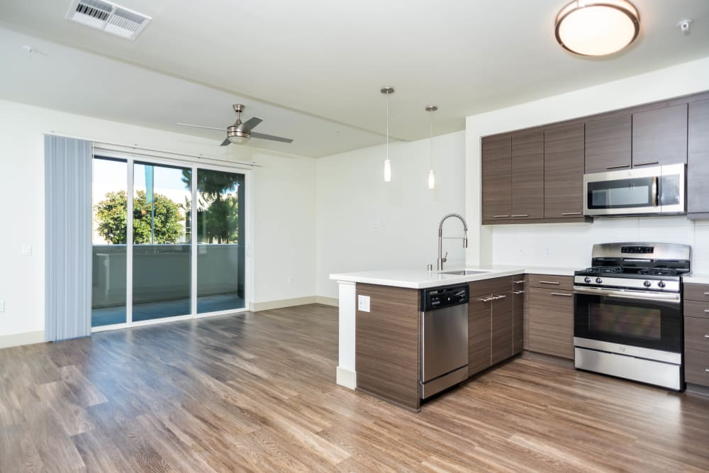Beautiful hardwood flooring in a model home at Fusion Apartments in Irvine, California