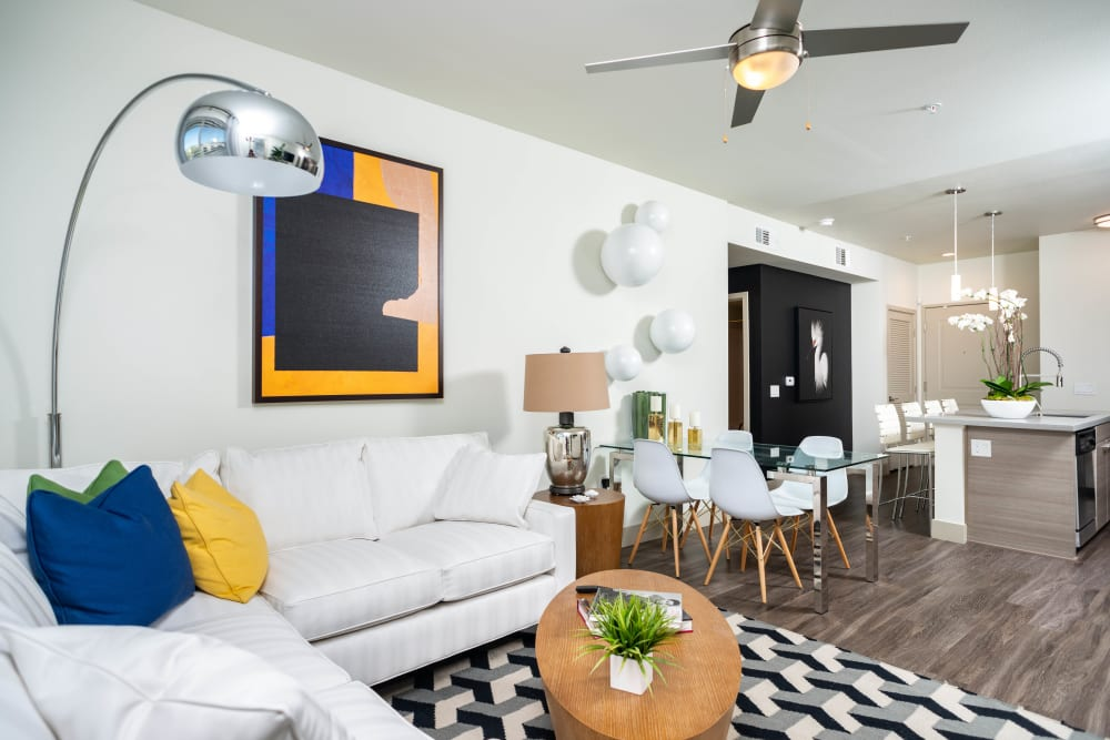 Ceiling fan and hardwood flooring in the living area of a model home at Fusion Apartments in Irvine, California