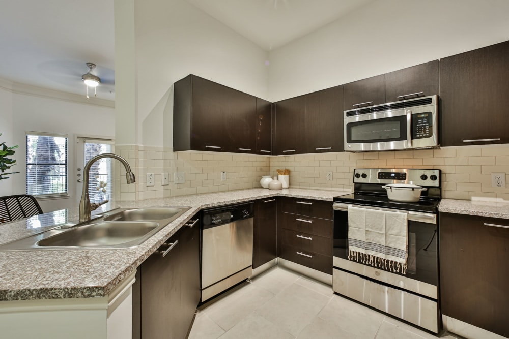 Kitchen in model apartment home at Broadstone Toscano in Houston, Texas