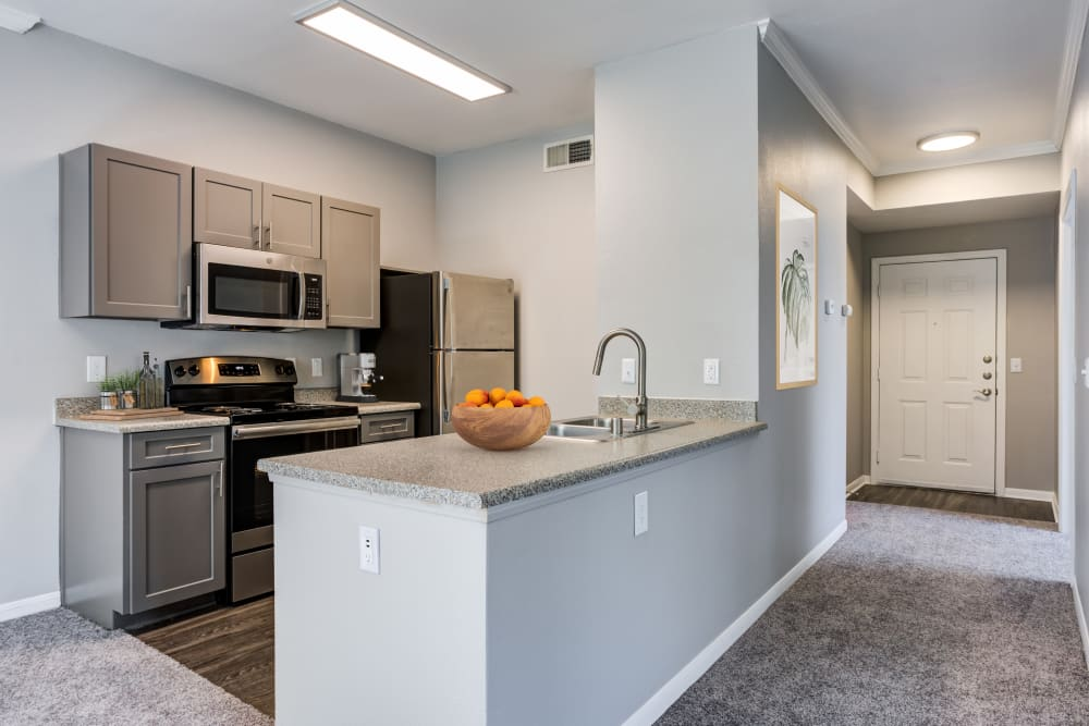 Renovated kitchen with grey cabinetry at Miramonte and Trovas in Sacramento, California