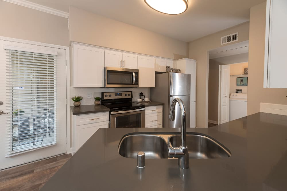 Kitchen with stainless-steel appliances at The Artisan Apartment Homes in Sacramento, California