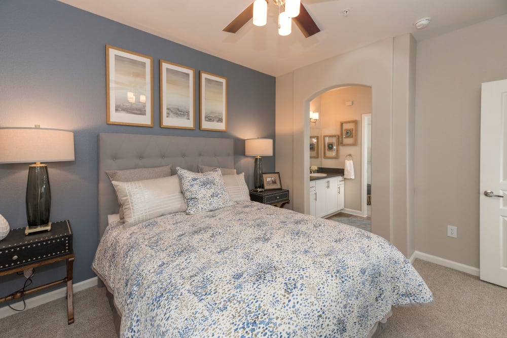 Large main bedroom with plush carpeting at The Artisan Apartment Homes in Sacramento, California