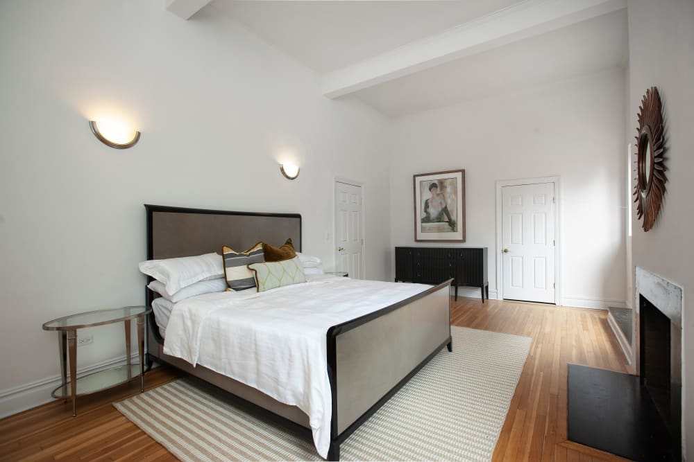Spacious main bedroom at The Sutton Collection in New York, New York