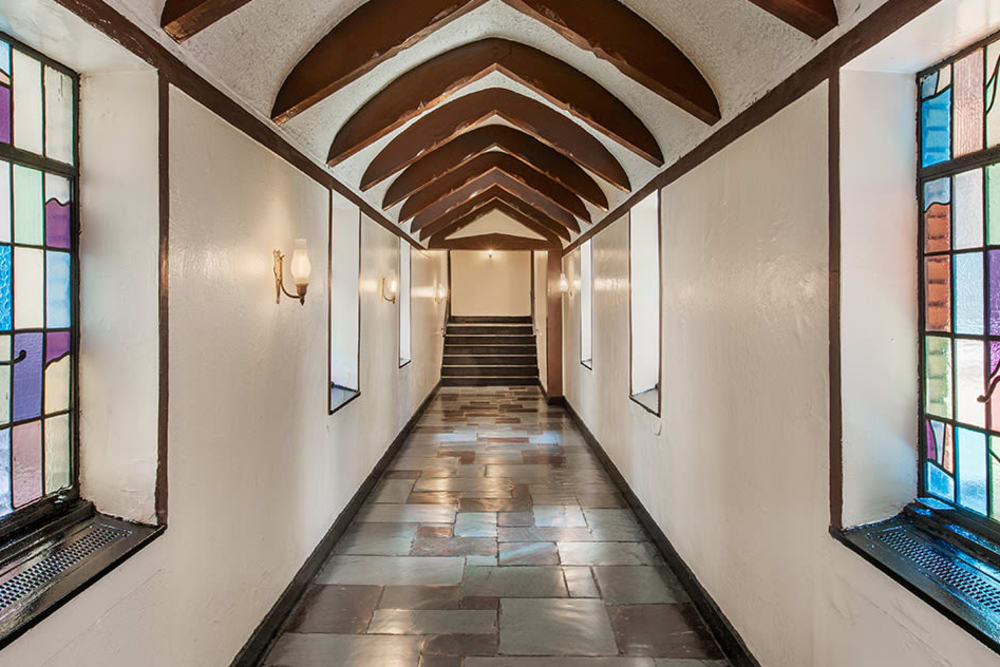 Cathedral-style hallway at The Sutton Collection in New York, New York