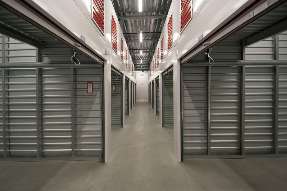 Large indoor storage units with the doors open at Trojan Storage in San Jose, California