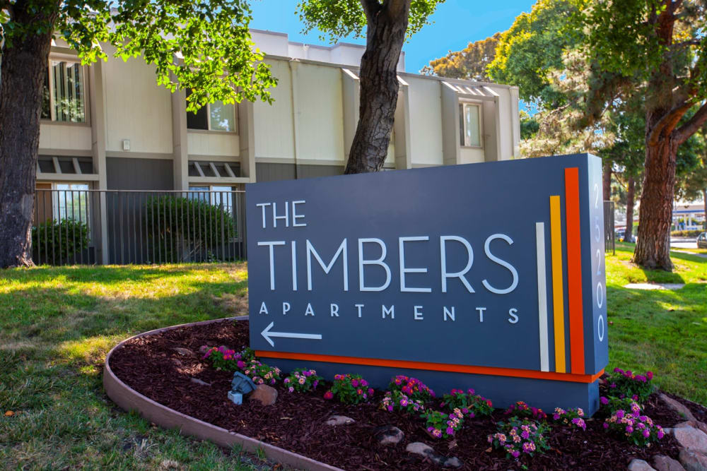 The front sign at The Timbers Apartments in Hayward, California