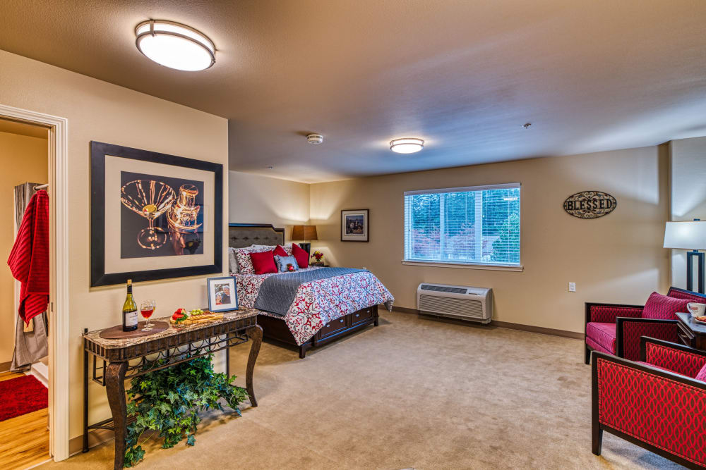 A large bedroom with a big window at Patriots Landing in DuPont, Washington.