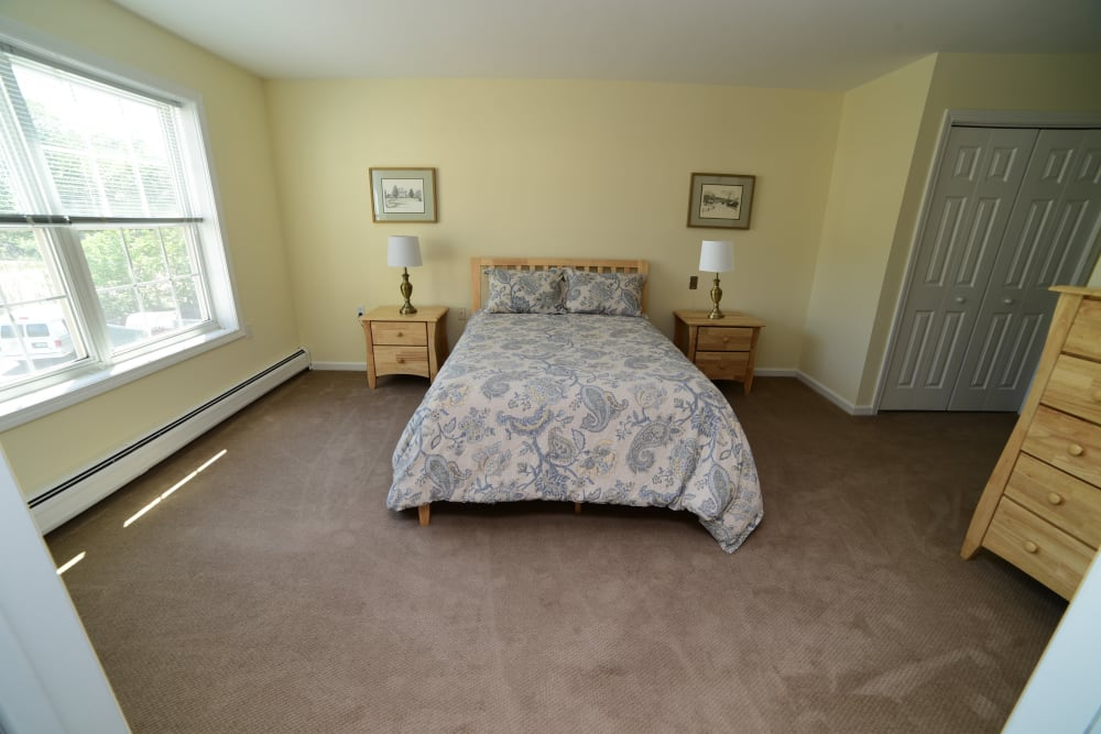 A comfortable bedroom at Harbor Village Senior Communities in South Burlington, Vermont