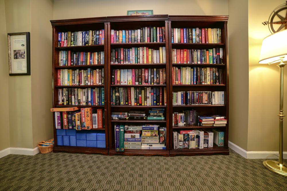 A full bookcase at Harbor Village Senior Communities in South Burlington, Vermont