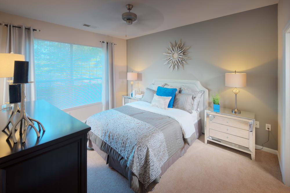 Large bedroom with blue accents at Preston View in Morrisville, North Carolina