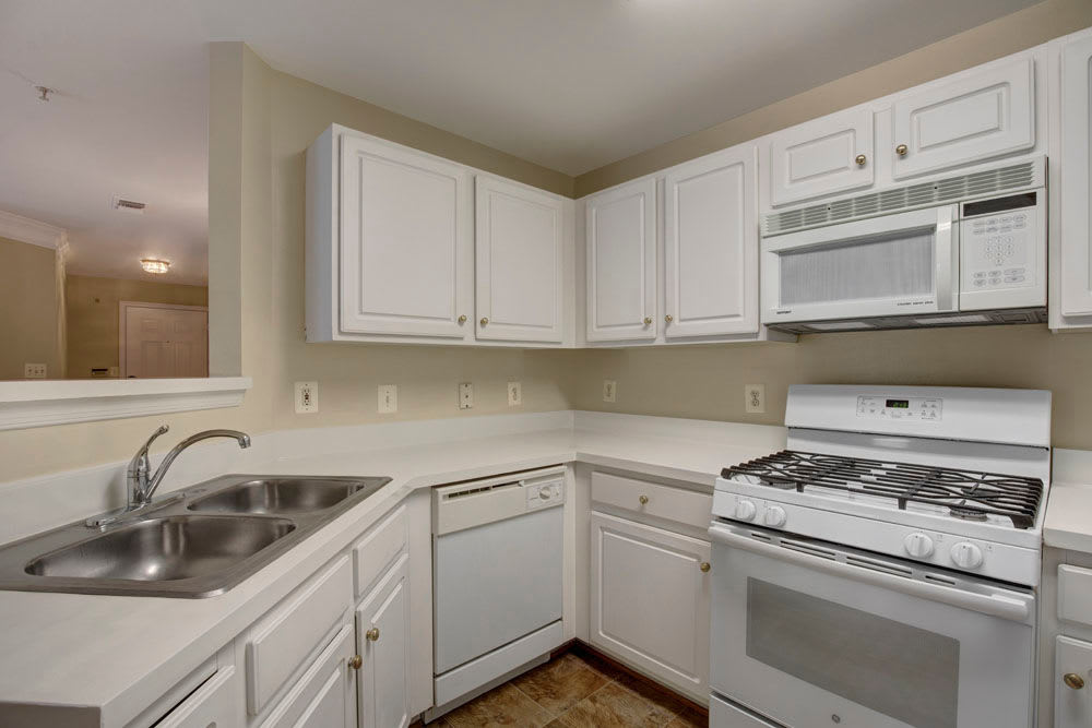 A spacious and bright white finished kitchen at Dulles Greene in Herndon, Virginia