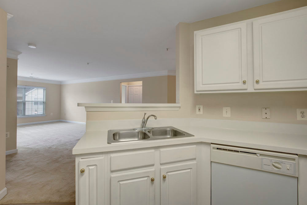 Kitchen sink and counters with view of the living room from the kitchen at Dulles Greene in Herndon, Virginia