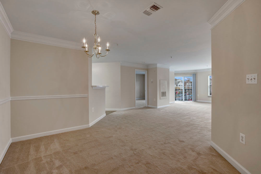 Spacious living room and dining space at Dulles Greene in Herndon, Virginia