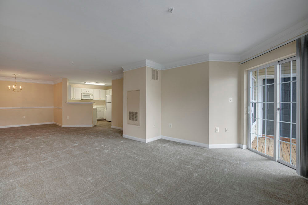 Spacious living room with access to outside at Dulles Greene in Herndon, Virginia
