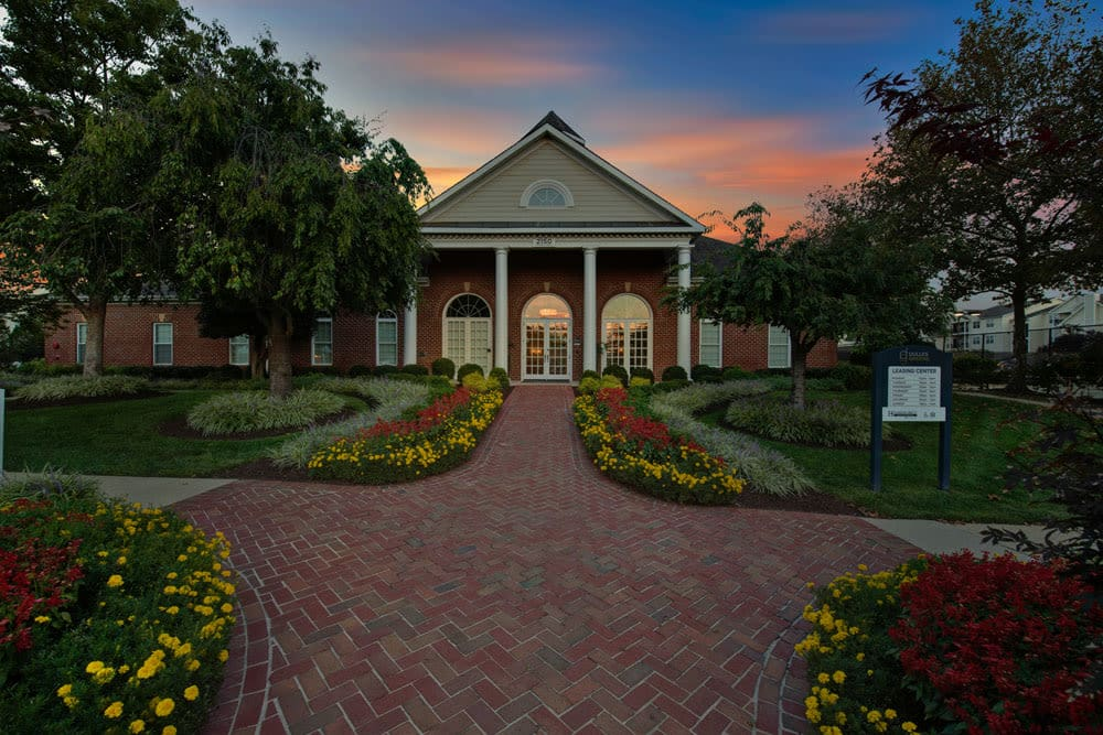 Beautiful outdoor sunset clouds over community clubhouse at Dulles Greene in Herndon, Virginia