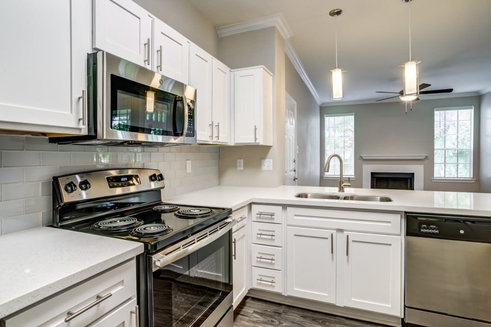 Kitchen with stainless-steel appliances at Signature Point Apartments
