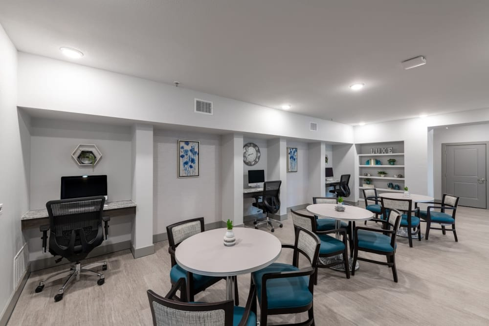 Activity room with computers for residents at The Luxe at Cedar Hill in Cedar Hill, Texas